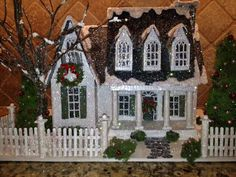 ArtTalk: Glitter house creator makes small replicas of buildings - Columbia Missourian Christmas Village Houses, Christmas Town, Putz Houses, Christmas Villages, Fairy Houses, Christmas Paper, Christmas Glitter, Doll Houses, Lemax Christmas