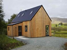 From the Isle of Skye comes the R.House by Rural Design Architects, a line of affordable prefabricated homes designed to fit in with the vernacular architecture and landscape of Skye. This is more of a modern house we might see built today. Prefabricated Houses, Prefab Homes, Tiny Homes, Modern Small House Design, Home Design, Vernacular Architecture, Building A Shed, Building Homes, Modern Barn