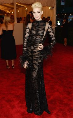 Anne Hathaway pairs her platinum blonde hairdo with a sexy black gown by Valentino. What do you think of her hair?
