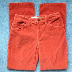 """Orange corduroy stretch boot cut petite jeans. Orange/rust color stretch, boot cut, petite. Five pocket, zip front. Top of zipper to crotch measures 7"""". Inseam measures 28 1/2"""". Leg hem width measures 16 1/2"""". Nice gently used condition. St. John's Bay Jeans Boot Cut"""