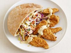 Get this all-star, easy-to-follow Falafel-Crusted Chicken With Hummus Slaw recipe from Food Network Kitchen