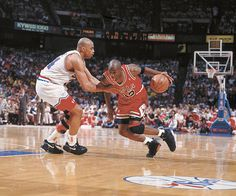 Michael Jordan dribbles Charles Barkley during a 1991 playoff game between the Bulls and Sixers.
