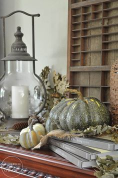 Use books to create different levels in your fall display.  |  www.andersonandgrant.com