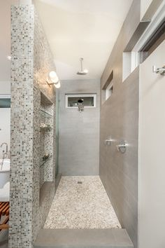 open walk in shower transitional-bathroom, pebble floor, with modern gray tile and accent mosaics