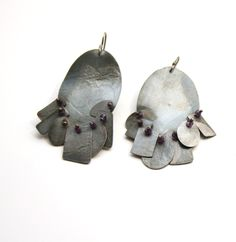 Oxidized sterling silver and amethyst earrings by Karen Gilbert. Gallery Lulo.