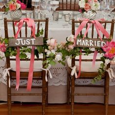 Hand-painted signs and pink peonies decorate these chairs