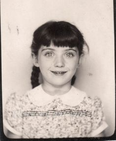 Vintage photobooth photo of a little girl with pretty eyes.