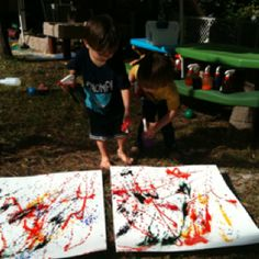 Spray bottle painting with liquid water colors in spray bottles on poster board! Fun and messy! Kids will love it.    #painting #kids #kidscrafts