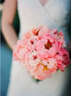 I'd love to make all-peony bouquets for your bridesmaids, Shirley, in tones from ivory to coral, with blush in between.