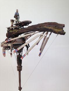 JOSEさん主催の「飛ばない理由Vol.2」http://tobanairiyuu.blog.fc2.comに投稿した作品です。  流木をメインに、ピンポン球や各種キット、金属線で構成しています。 流木はオイルステインを塗ったうえに、鉄道模型などのパウダーで苔などを表現してみました。ツタは雑草の根っこを熱湯に通して乾燥させた物です。 今回、初めてジオラマ的な物をやってみましたが、難しくて面白かったです。  現物は今月のタマミーに持っていきますので、よろしくお願いします。
