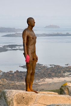 The Anthony Gormley sculpture named 'Another Time' overlooking Herm Island, Channel Islands, UK