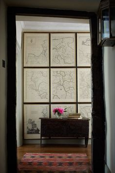 Discover ideas for displaying art on HOUSE - design, food and travel by House & Garden. This map collection spanning floor to ceiling takes on the look of a mural.