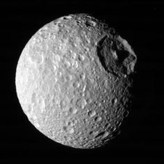 That's no moon! But wait yeah no it actually is a moon - Mimas,...