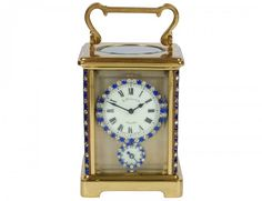 BRASS CARRIAGE CLOCK WITH ALARM. Early 20th c.
