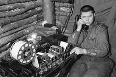 Soviet soldier using sound detection equipment to locate hidden German artillery positions during the Second World War.