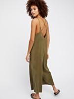 Wide Leg One Piece | Easy and effortless soft jumpsuit features in a slouchy silhouette.    * Wide legs   * Ankle grazing inseam   * Hips pockets   * Low back   * Crisscross straps in back
