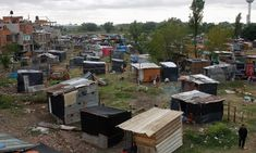 Makeshift shelters are scattered all over the 'Pope Francis' squatter settlement in Villa Lugano. Photograph: Reuters