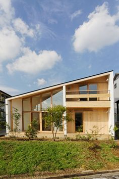 dandan1 house with mono pitch roof. Wooden home. Architecture