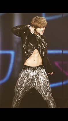 Luhan EXO-M... Who knew that cute little deer actually had abs under his shirt??