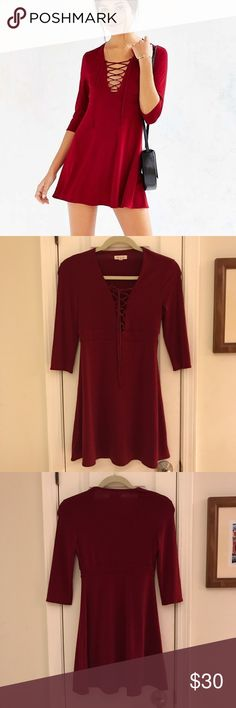 """Urban Outfitters Lace Up Fall Mini Dress Size S 💃 Gorgeous for fall!🍂🍁 Perfect 3/4 sleeve mini dress with lace up detail in front. Urban Outfitters' Silence + Noise brand.  Red. Polyester/Spandex. Excellent pre-owned condition. 30"""" long from highest point to bottom hem. 😘 Urban Outfitters Dresses"""