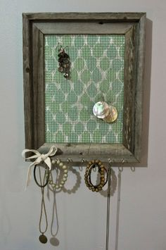 Im thinking use something like this in the Kitchen to hang car keys and the dog leash and use framed area to take up notes/reminders