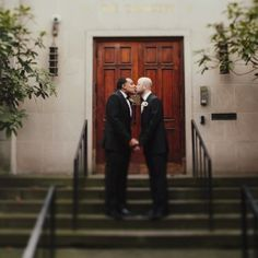 I love the simplistic background of the wooden door and the olive leaves around | Real Wedding: Gary Ireland and Gilbert Archuleta | Photo by: James Moes | Seattle Met Bride and Groom W/S 13