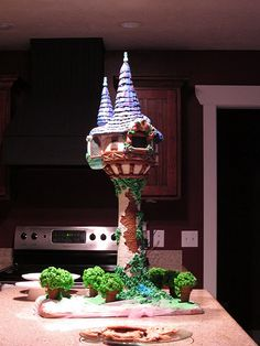 Amazing tangled tower cake love that movie.  I actually made a cake like this for Jazz's 5th birthday.