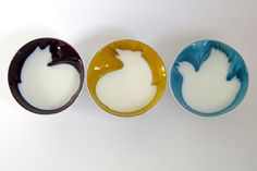 """These 'hidden animal cereal bowls' by Geraldine De Beco.  """"When the bowls are empty, they appear to have strange carvings around the edges, but when the bowls have liquid in them, the form of an animal magically appears."""""""