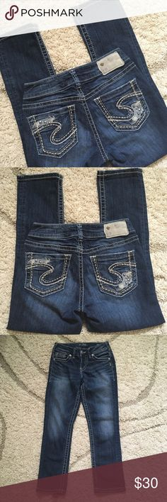 """SILVER Suki Capri Jeans Silver Suki mid capri jeans are distressed in a dark wash with some slight fading. The back pockets are embellished with metal stud accents. These have been pre-loved and are in excellent used condition. Label shows waist 25"""" / length 22 1/2"""" / I measured waist 13"""" lying flat and length 24""""                           -Offers are welcomed- Silver Jeans Jeans Ankle & Cropped"""