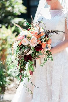 Peony and feather cascading bridal bouquet http://ajdunlap.com/biltmore-forest-country-club-wedding/