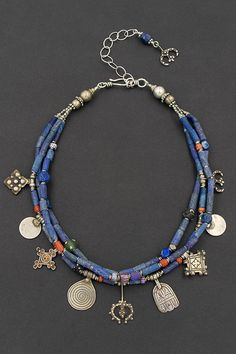 Lapis bead necklace with Berber silver amulet charms, old Moroccan coral, old African glass trade beads, and Afghan silver. One of a kind with a boho tribal vibe. Modern ethnic jewelry by Angela Lovett Designs