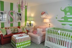 So many fun #green features in this #nursery!  #elephant #stripewall #pinkglider #pinkchandelier