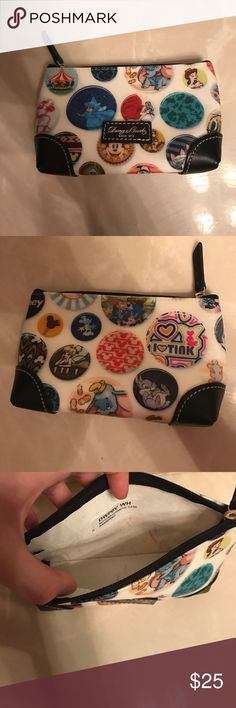 Dooney and Bourke Disney Pouch Disney Dooney and Bourke pouch there is some crayon markings on the inside (reflected in price) but the outside is in perfect condition. Can fit your phone and some money. Or whatever you'd like! Dooney & Bourke Bags Cosmetic Bags & Cases