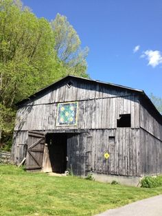 """Old barn with quilt motif. I think this is a new-ish fad, painting quilt blocks onto barns. I like it, similar to the old PA Dutch """"hex"""" signs, that were meant to ward off evil from the farm & its family."""