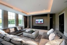 Family room - love the colour scheme, tv cabinet and furniture layout