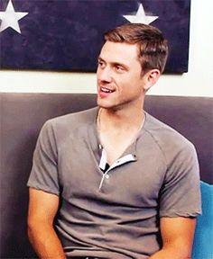 Aaron Tveit... its kinda weird how his arms look dark but his face looks paler..