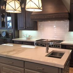 porcelain Pietra Calacatta counter tops and Arden beveled tiles.…@annsacks