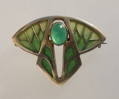 This is not contemporary - image from a gallery of vintage and/or antique objects. LEVINGER & BISSINGER  Jugendstil Brooch  Gilded silver Plique-à-jour enamel