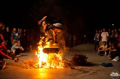 This is a Picture Nyjah Huston Doing a Backside Flip over a Fire.