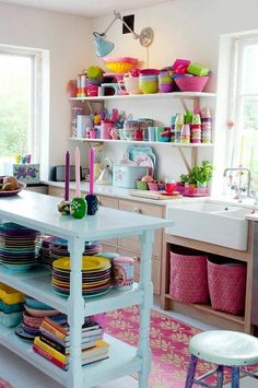 A great way to jazz up a simple kitchen is through the use of colourful plateware! The exposed shelving units allow the fun colours to take centre stage!