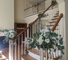 Arrangements for staircase/railing for home wedding.  Large arrangements for newells, greenery/some florals for handrail going up.