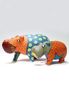 painted wooden hippos from artists scattered throughout Zimbabwe
