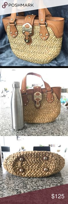 Michael Kors straw bag Straw and leather  hand bag michael kors . Really cute summer bag authentic medium size and you see next to the water bottle. It holds quite a bit. I actually love it but my closet have me a ultimatum to downsize or explode. Bags Totes