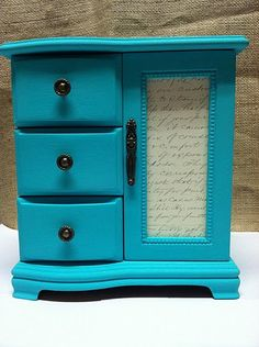 Hand painted teal musical jewelry box with peacock feather