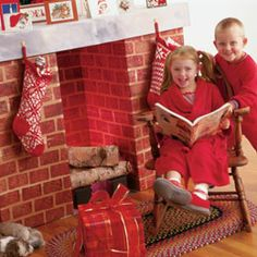 For those whose Christmas holiday lacks a chimney by which to hang stockings with care, this easy-to-build cardboard fireplace makes a great stand-in.  - Xmas Card setting?