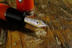 Sailor two-tone nib on Pro Gear Orange. Beautiful nib, and the world needs more orange pens! Expensive Pens, Fountain Pen Reviews, Fountain Pen Nibs, New Pen, Gears, Sailor, Dip, Graphics, Orange