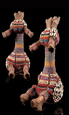 Africa   Doll from the Fali people of Cameroon   Bone, glass beads, cowrie shells and natural fiber.