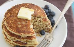 Fold it into pancakes.  http://www.prevention.com/eat-clean/7-genius-ways-to-use-up-leftover-quinoa/slide/1