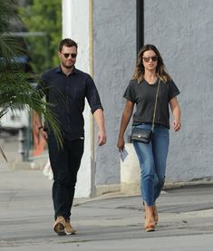 Jamie Dornan was a far cry from brooding Lothario Christian Grey on Tuesday as he played the part of the doting husband with his wife Amelia Warner while out and about in Los Angeles. Fifty Shades Movie, Fifty Shades Of Grey, Amelia Warner Jamie Dornan, Jaime Dornan, James Patrick, Christian Grey, Stylish Men, Mom Jeans, How To Look Better