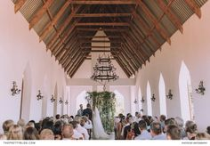 An old-world church in Tulbagh was decorated with a novel installation of foliage, for a laid-back couple's wedding ceremony. | Photographer: Kikitography | Coordinator: Weddings by Andrea | Florist: Anli Wahl Floral Design